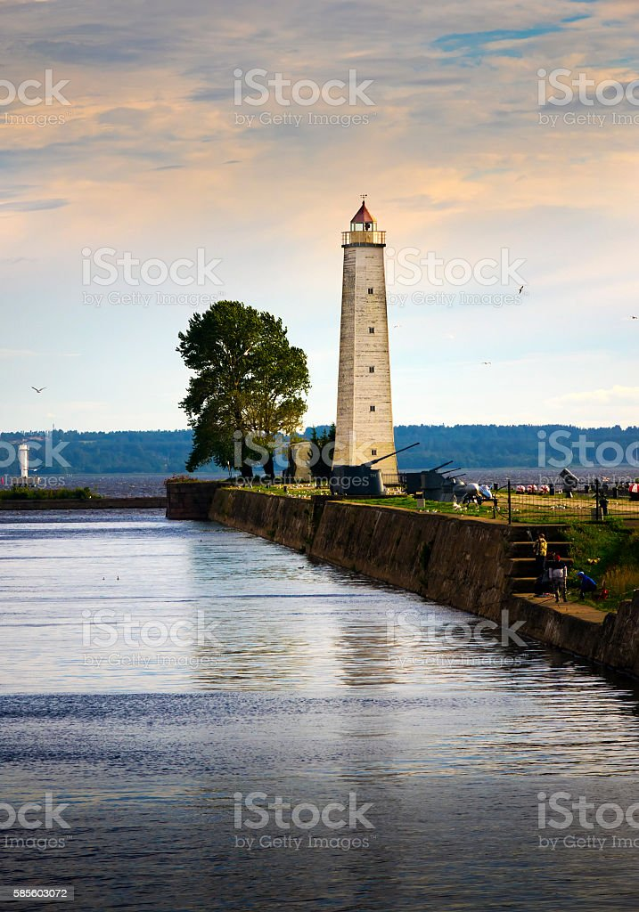 Kronstadt promenade to  pier with a lighthouse . St. Petersburg.Russia. stock photo