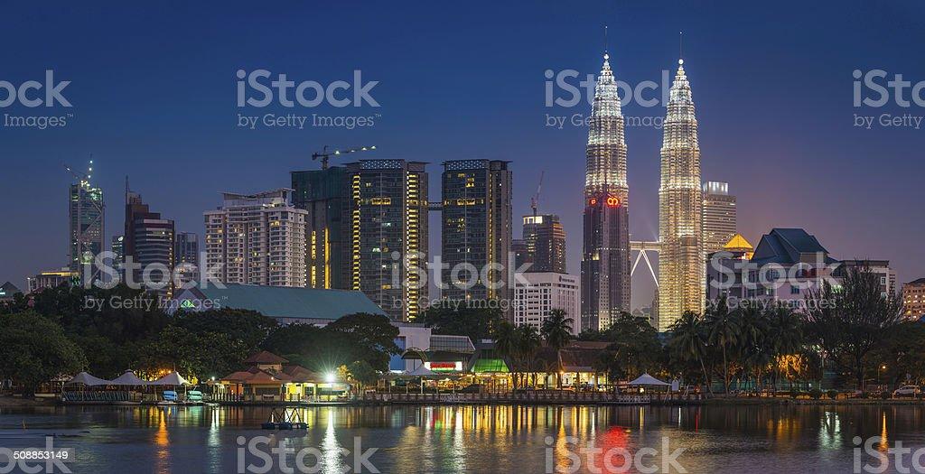 Kuala Lumpur Petronas Towers downtown skyscrapers illuminated blue dusk Malaysia stock photo