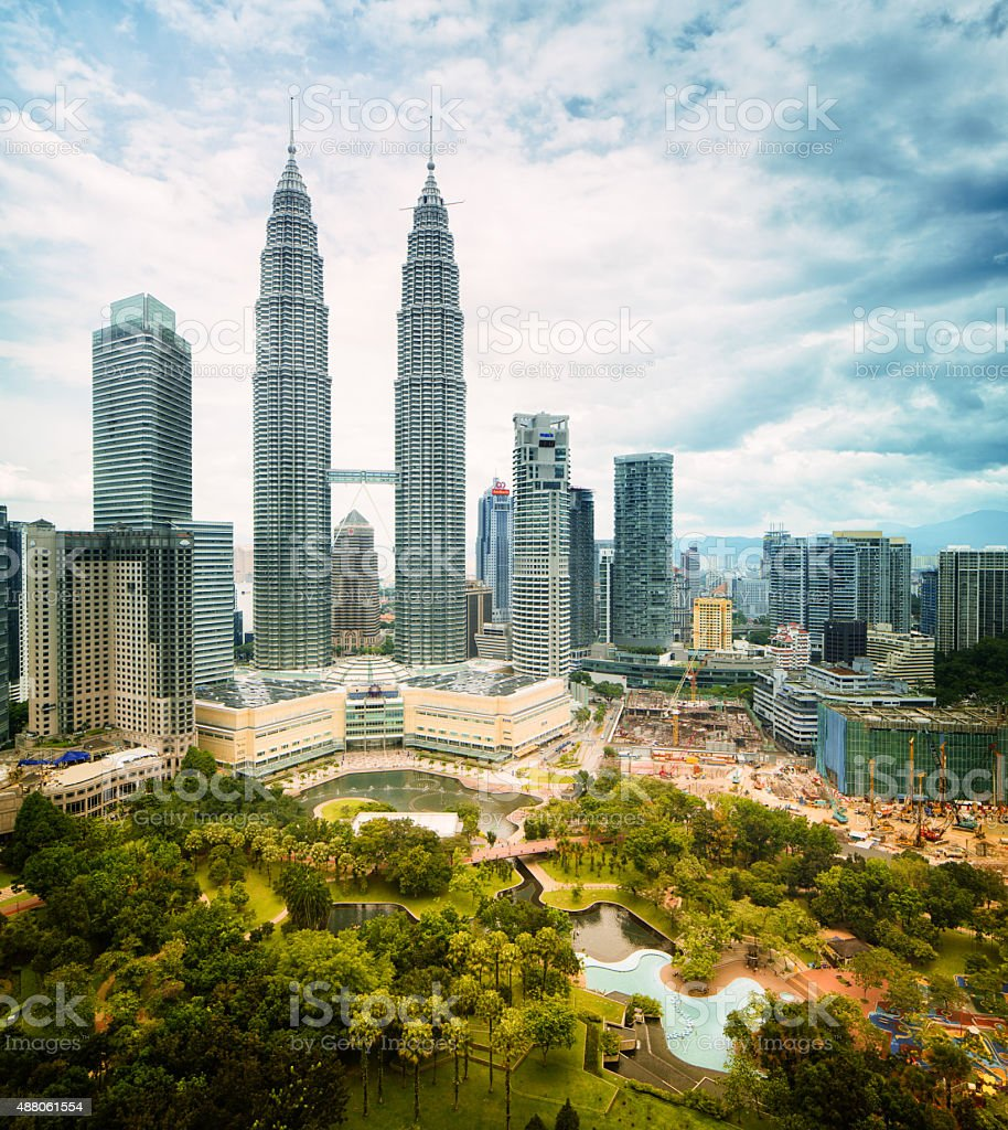 Kuala Lumpur skyline daytime featuring Petronas towers stock photo
