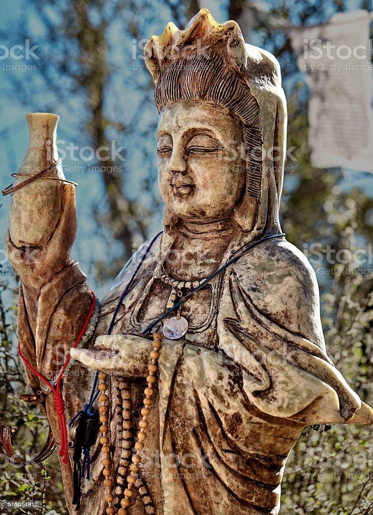 kuan yin bodhisattva of compassion at sunset stock photo