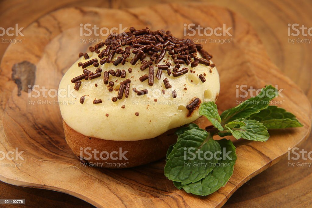 Kue Cubit on a Wooden Plate stock photo