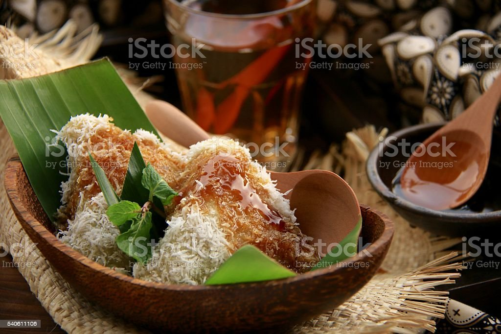Kue Lupis on Coconut Wooden Bowl stock photo