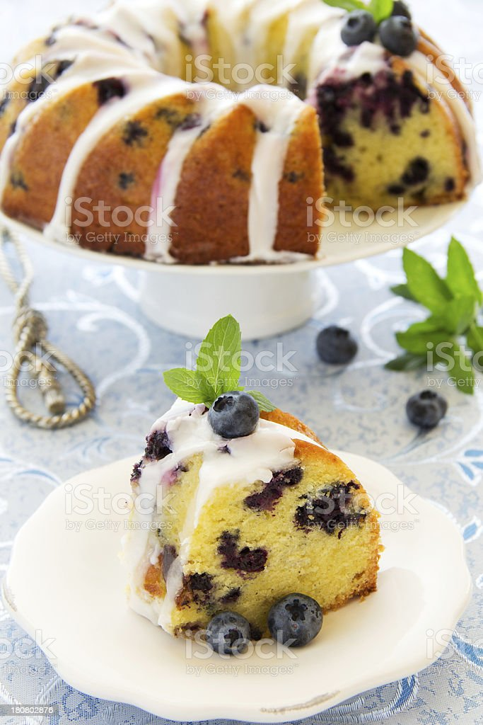 Kugelhopf cake with blueberries and lime royalty-free stock photo