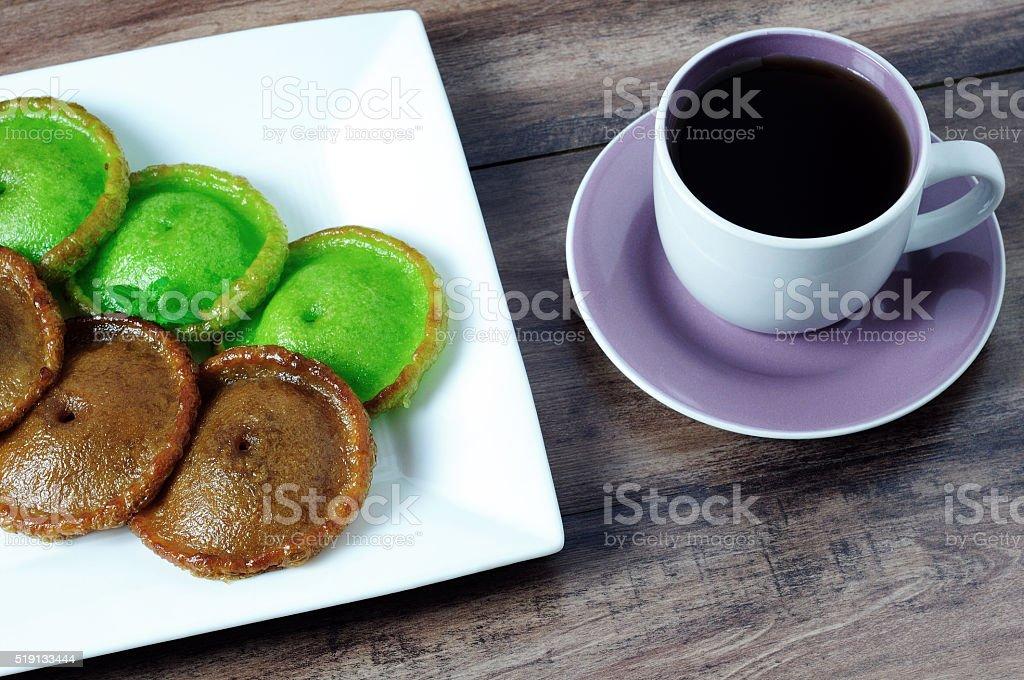 Kuih Pinjaram and a cup of coffee. stock photo
