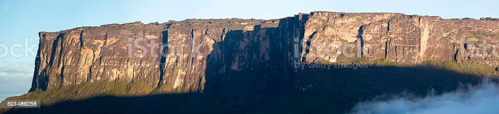 Kukenan tepui or Mount Roraima with clouds and blue sky stock photo
