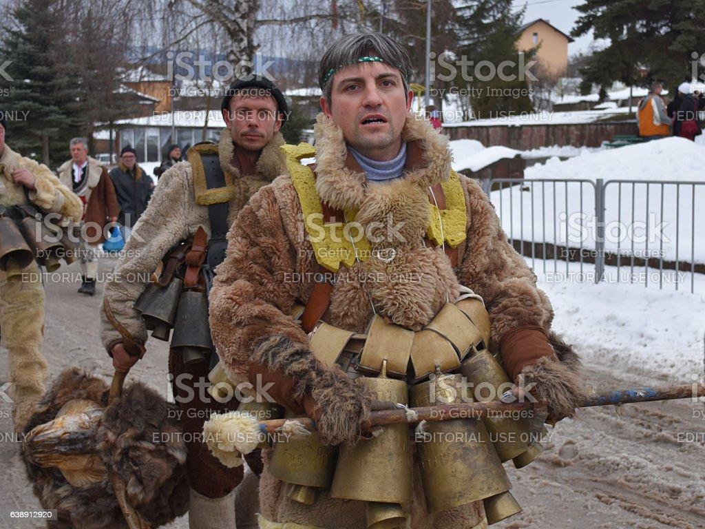Kukeri on the snowy street of Yardzhilovtsi village stock photo