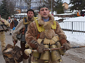 Kukeri on the snowy street of Yardzhilovtsi village
