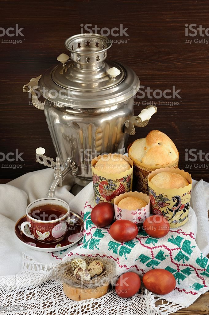 Kulichi, traditional Russian easter cakes with samovar, black te stock photo
