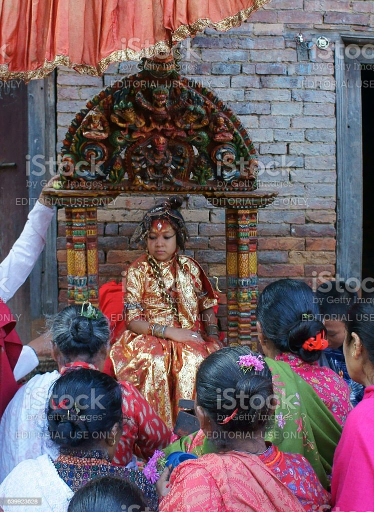 Kumari of Bhaktapur receives offerings by devotees stock photo