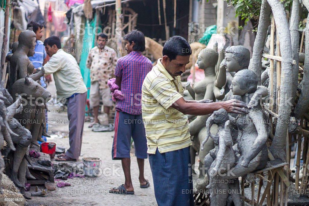 Kumartuli artists making sculpture. stock photo