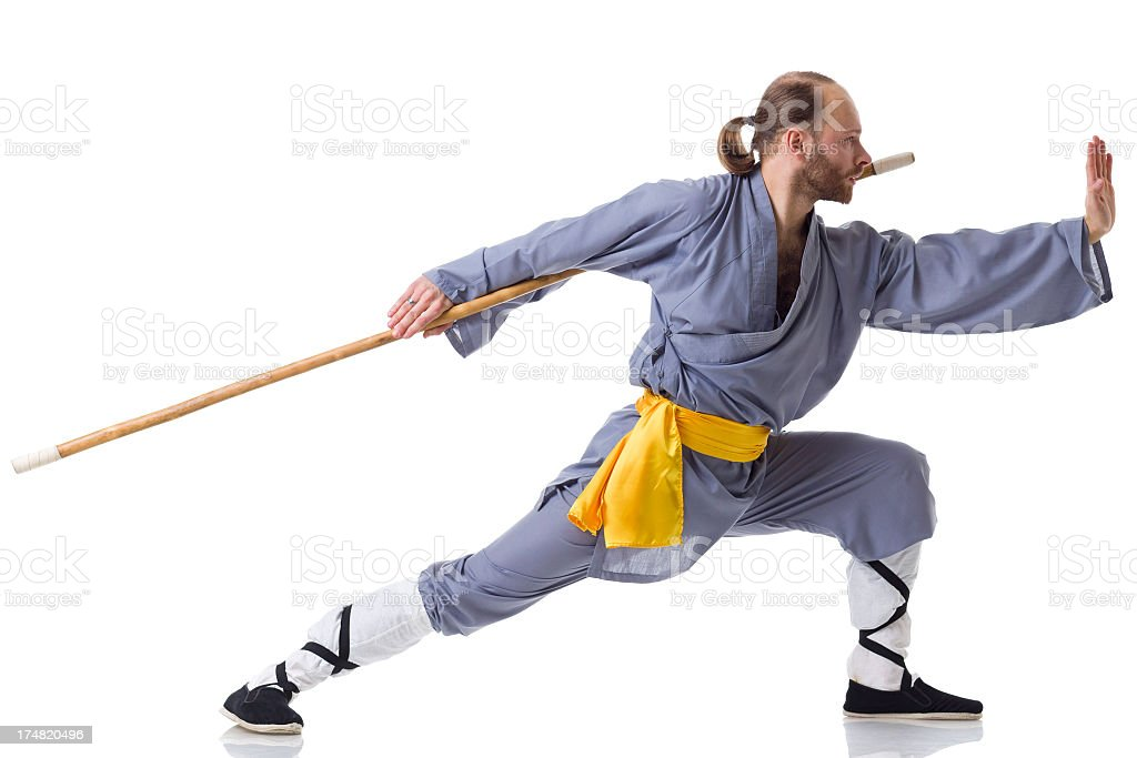 Kung Fu fighting position with Wooden Stick isolated on white royalty-free stock photo