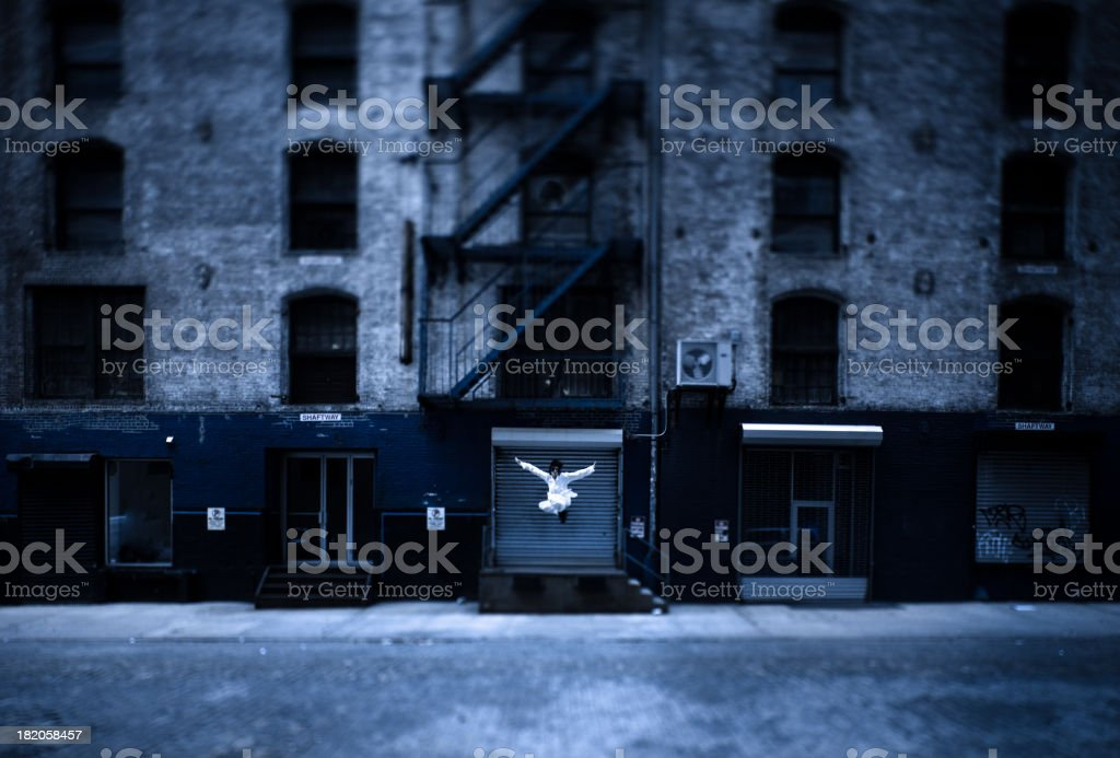 Kung Fu Warrior leaping from an abandoned building royalty-free stock photo