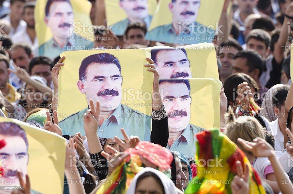Kurdish protestors showing the poster of Abdullah Ocalan royalty-free stock photo