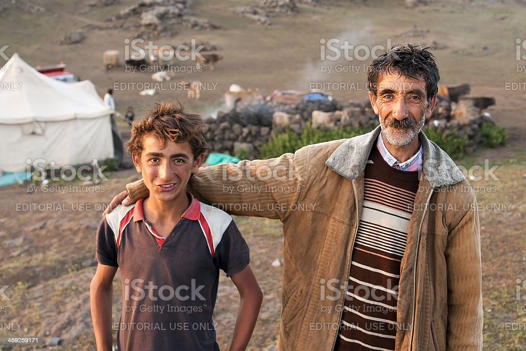 Kurdish Transhumant  Man With His Son royalty-free stock photo