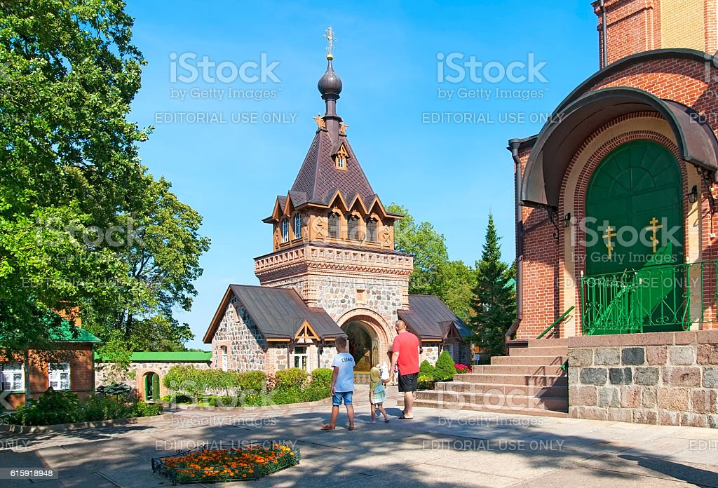 Kuremae, Estonia. People near Dormition Cathedral stock photo