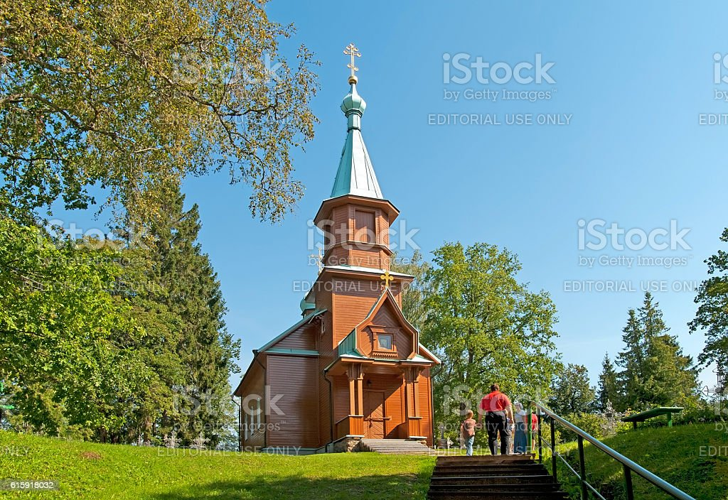 Kuremae, Estonia. People near St Arsenius and St Nicholas Church stock photo