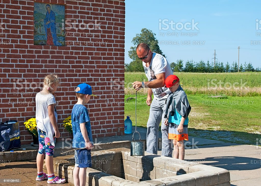 Kuremae, Estonia. People near The Holy Spring stock photo