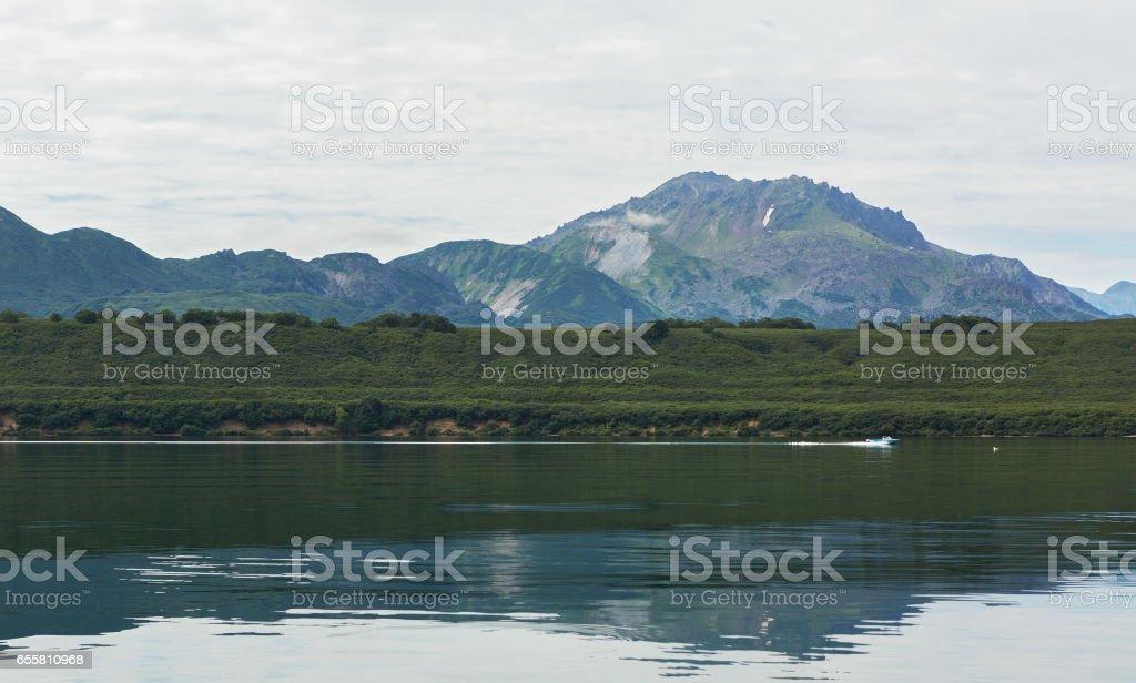 Kurile Lake is caldera and crater lake in Eastern Volcanic Zone of Kamchatka stock photo
