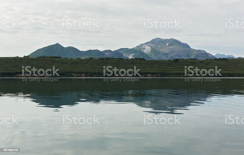 Kurile Lake is caldera and crater lake in Eastern Volcanic Zone of Kamchatka stock photo