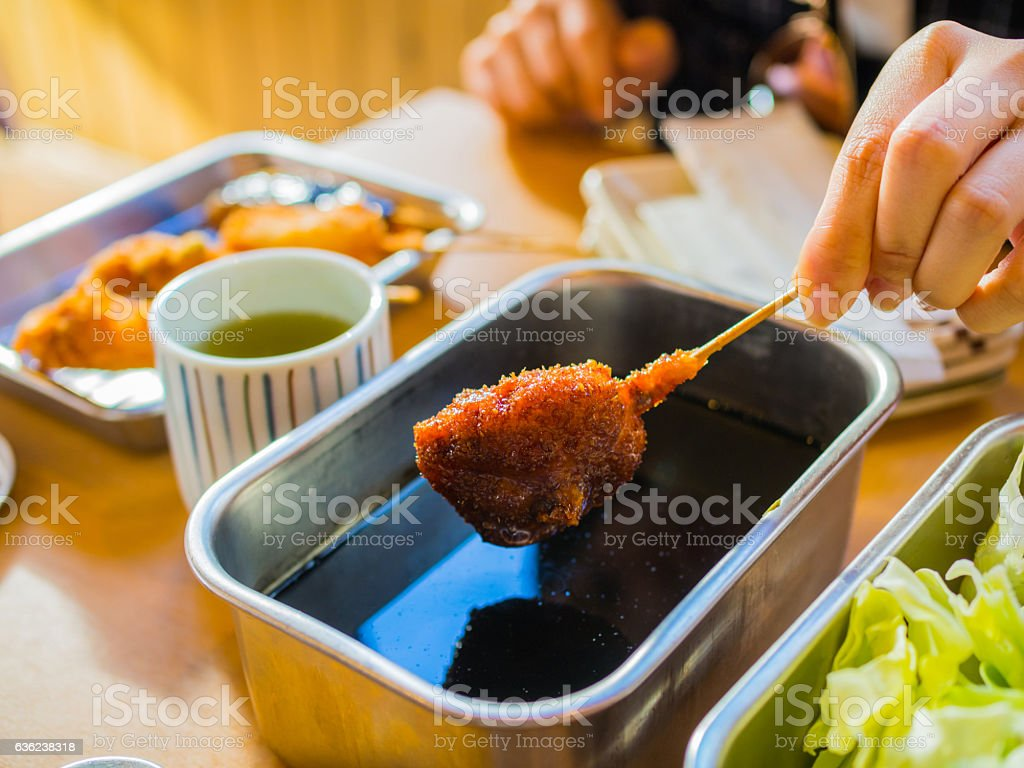 Kushikatsu, Japanese dish of deep fried skewered meat and vegetables stock photo