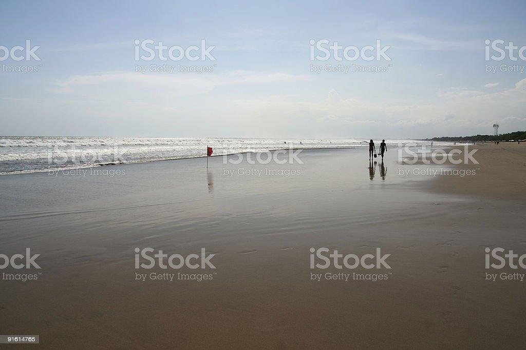 kuta beach couple bali indonesia royalty-free stock photo