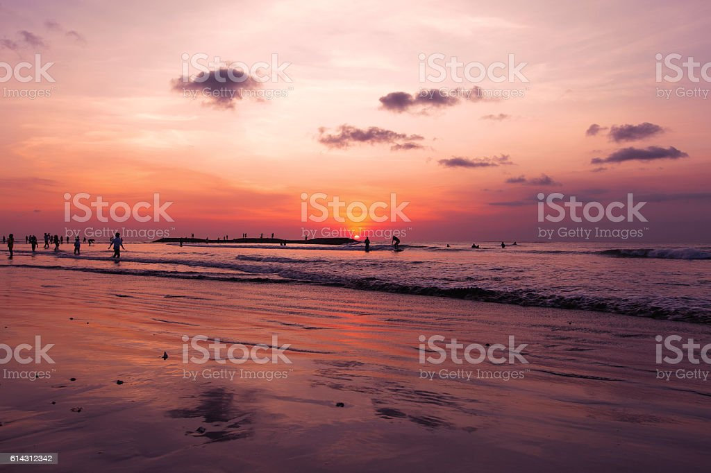 Kuta Beach sunset with Bali stock photo