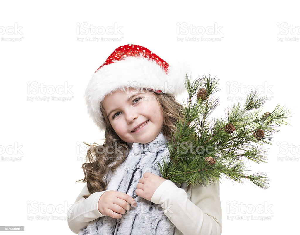 kute girl in santa claus hat holding fir branch royalty-free stock photo