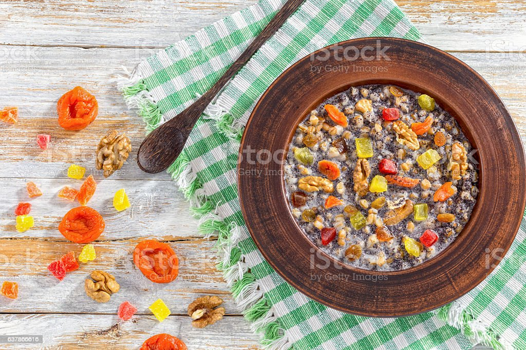 kutia with nuts, poppy seeds, dried fruits. succade and honey stock photo