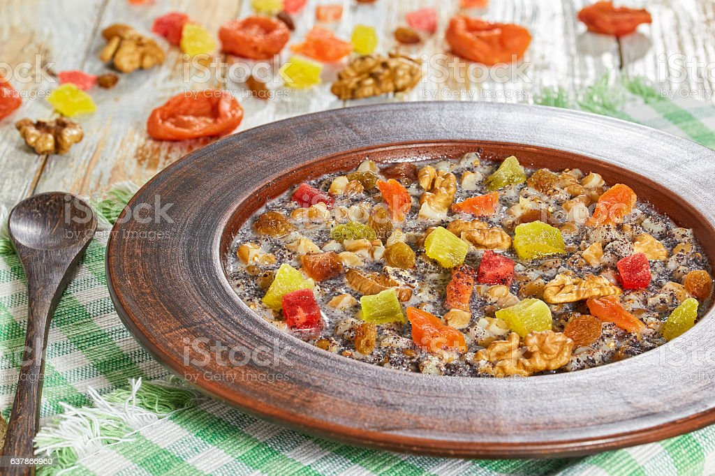 kutia with nuts, poppy seeds, dried fruits, succade and honey stock photo