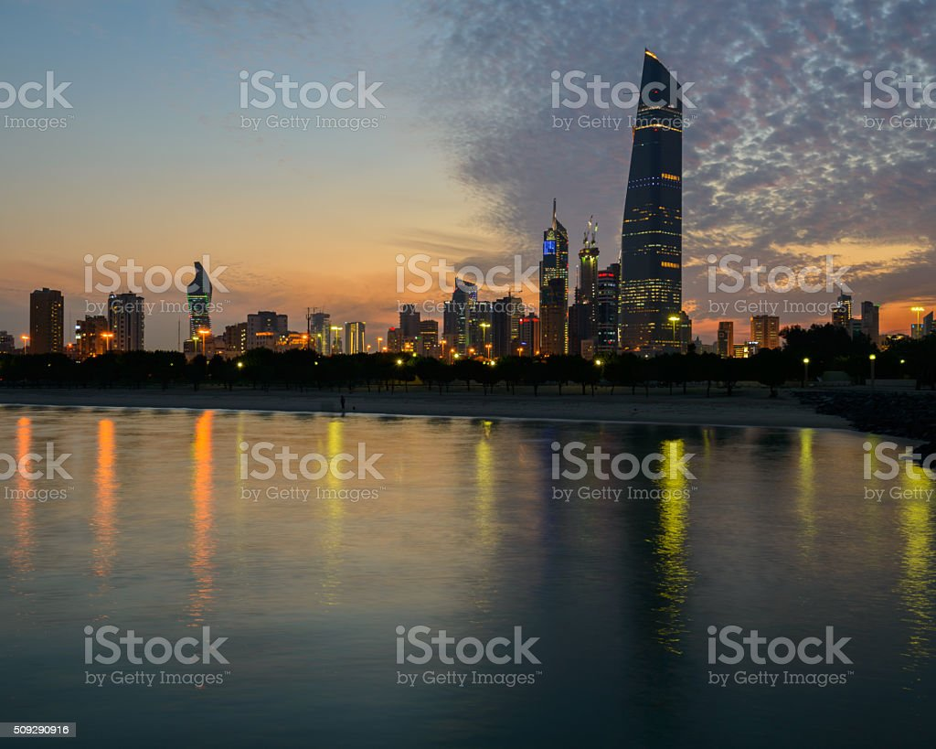 Kuwait City skyline at sunset, featuring Al-Hamra stock photo