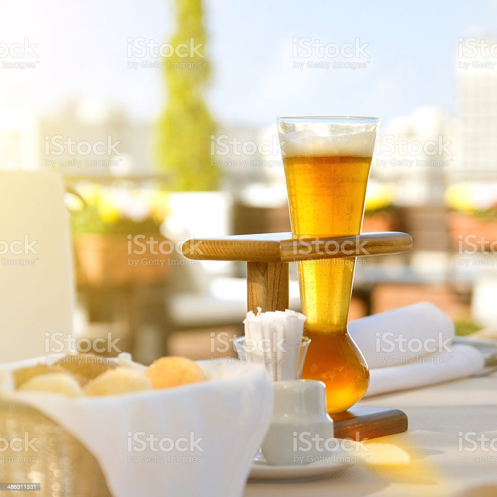 Kwak beer on the served table. Outdoors photo. stock photo