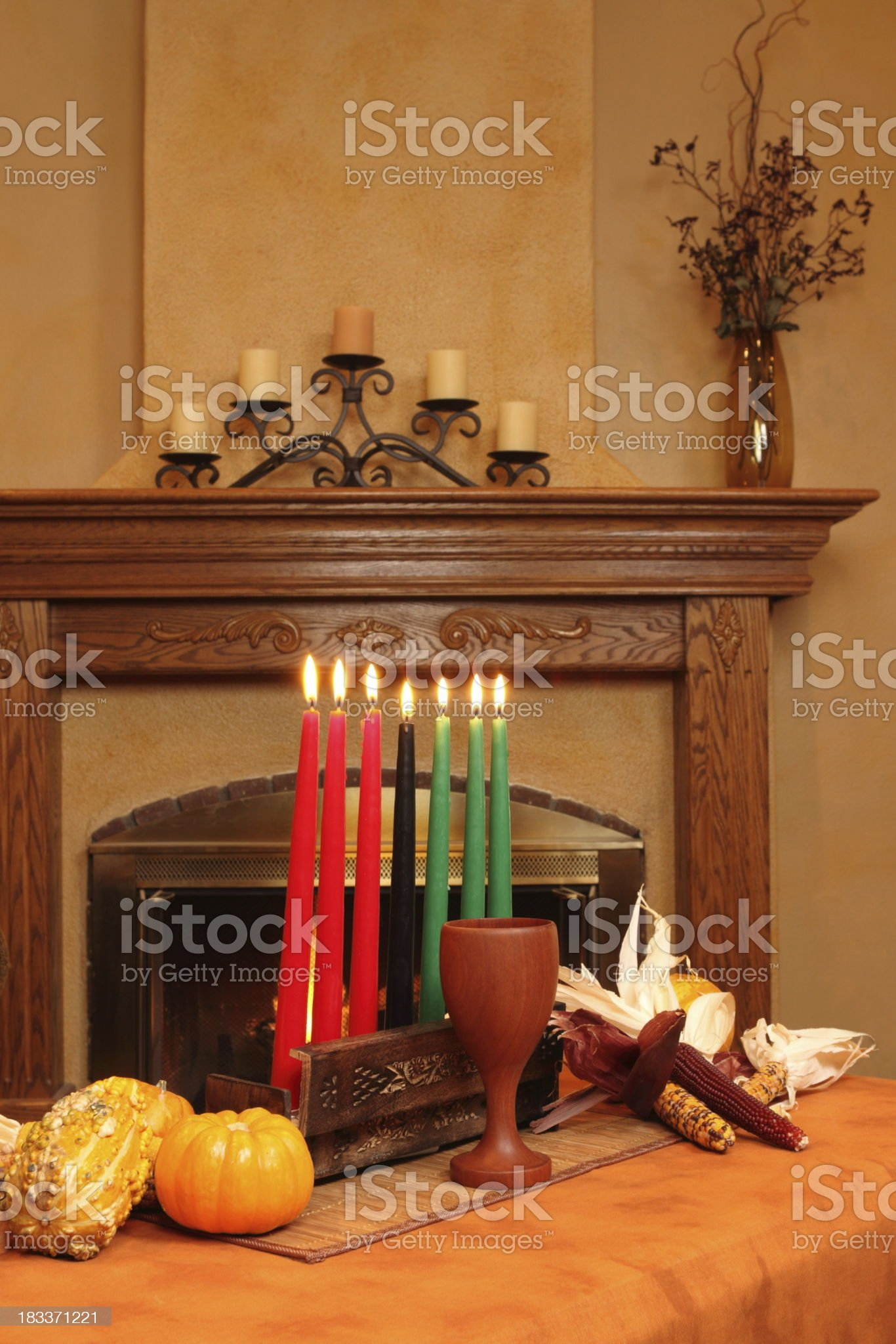 Kwanzaa Candles By Fireplace All Lit Vertical royalty-free stock photo