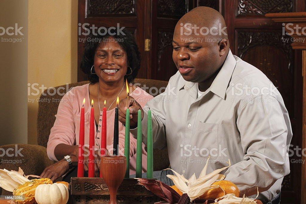 Kwanzaa Couple Horizontal Red Candles Lit stock photo