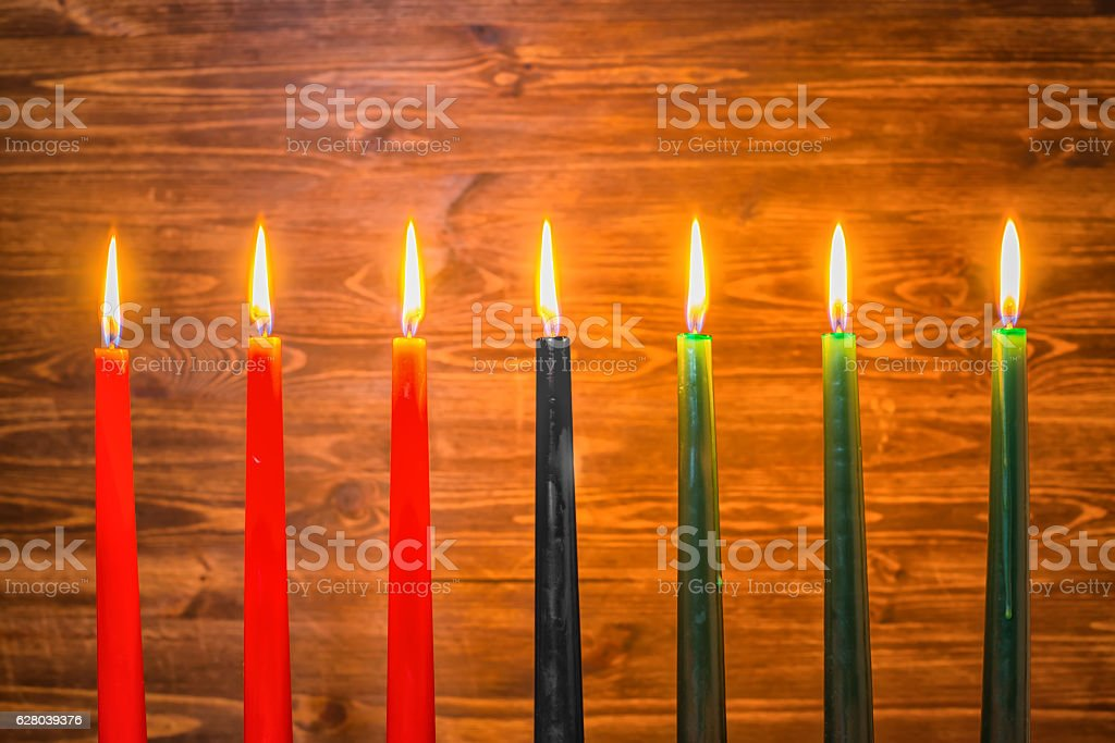 Kwanzaa festival concept with seven candles red, black and green stock photo