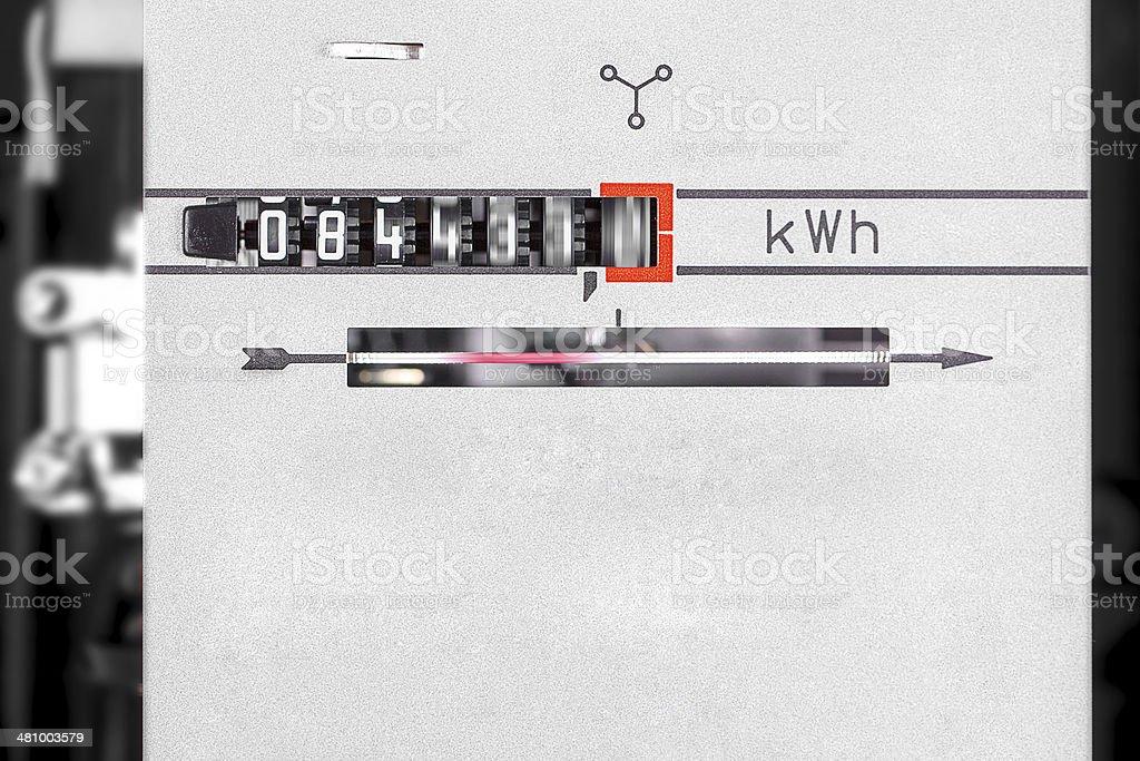 kWh dial - runing power measurement machine close-up stock photo