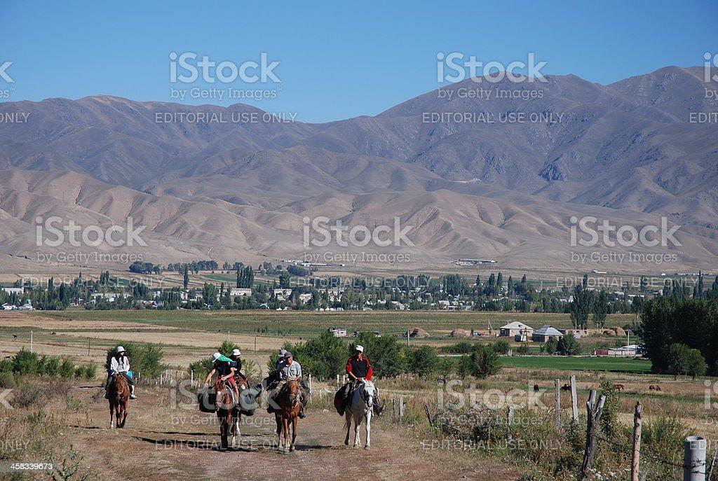 Kyrgyz horsemen in Tschon-Kemin Nationalpark royalty-free stock photo