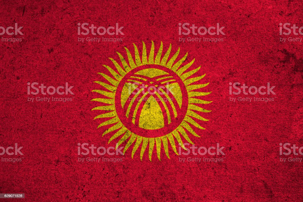 Kyrgyzstan flag on an old grunge background stock photo