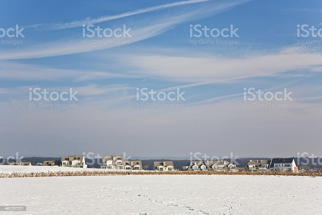 l landscape with  housing area in snow and blue sky royalty-free stock photo