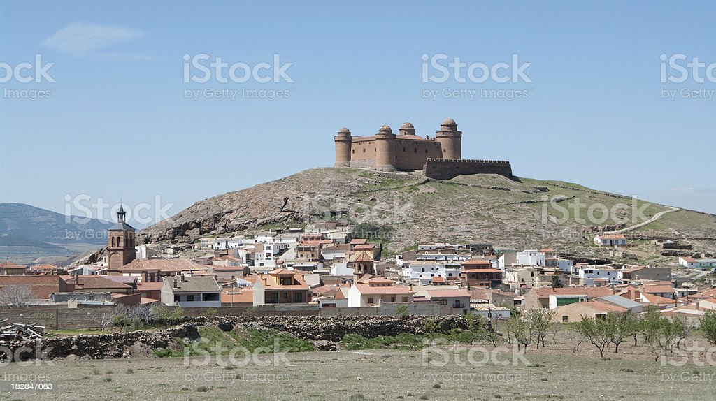 La Calahorra village with the castle atop royalty-free stock photo