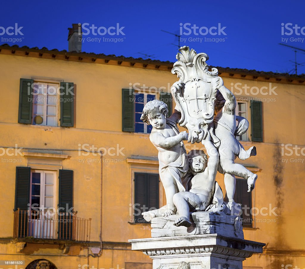 'La fontana dei putti by night in Pisa, Tuscany Italy' stock photo