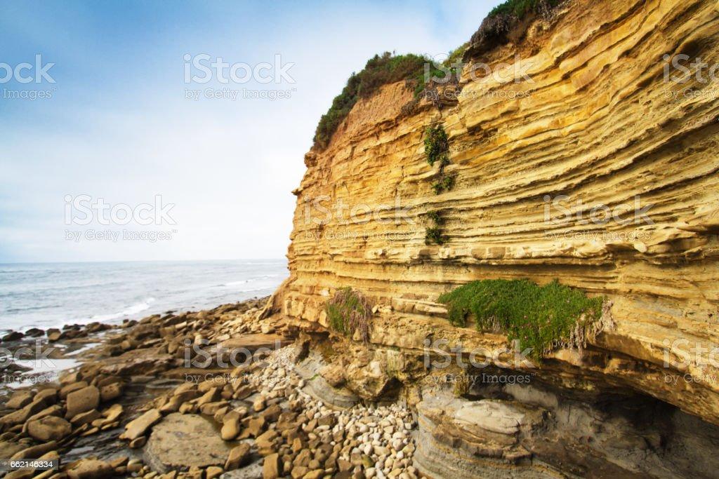 La Jolla, CA: Orange-Yellow Ocean Cliffs (Close-Up) stock photo