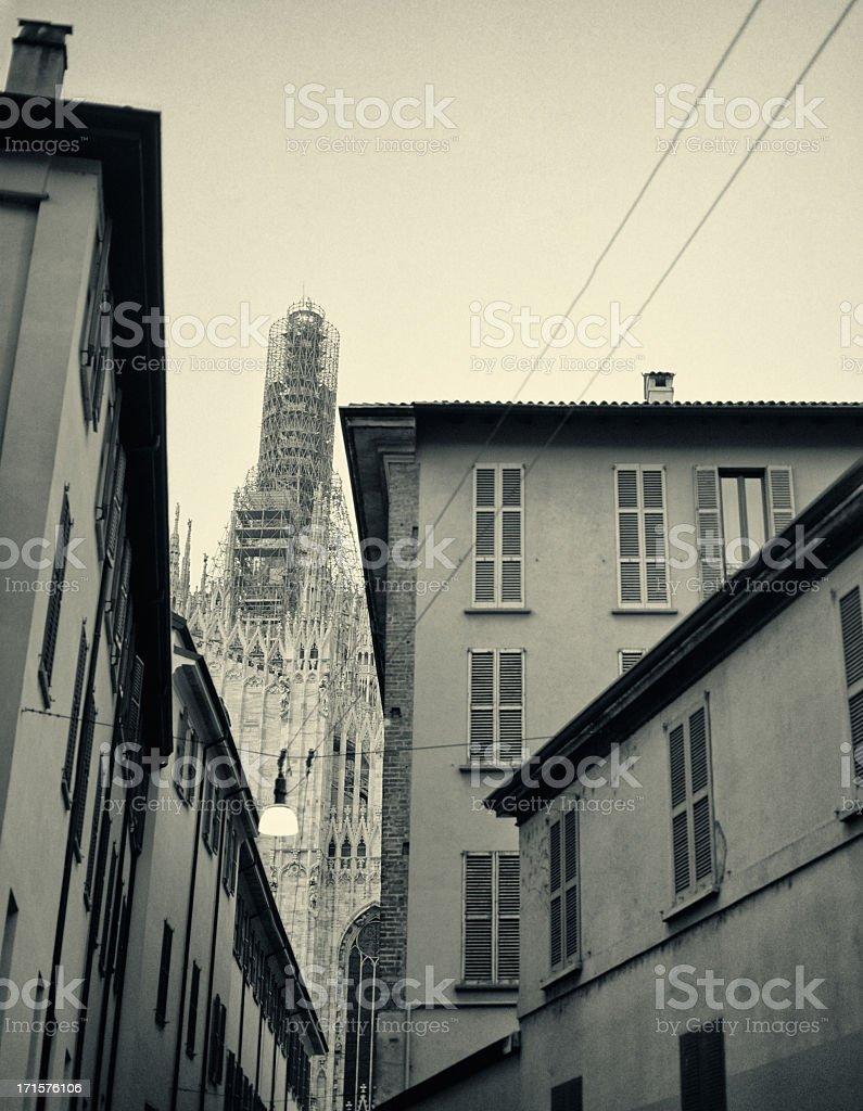 La Madonnina on top of the Duomo is undergoing restoration stock photo