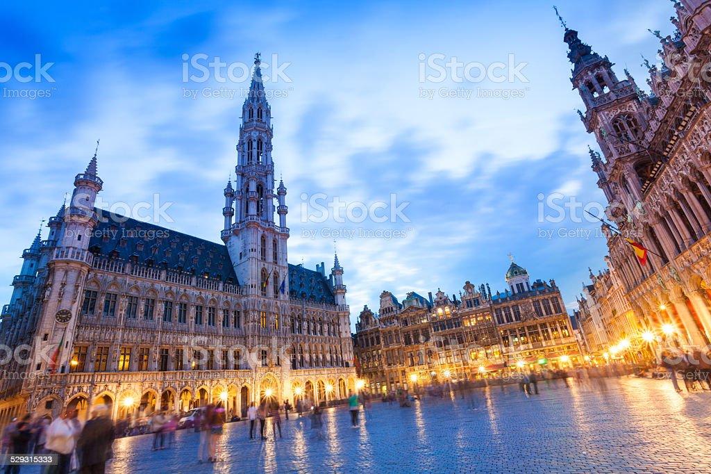 La Meuse et l'Escaut on Grand Place at night stock photo