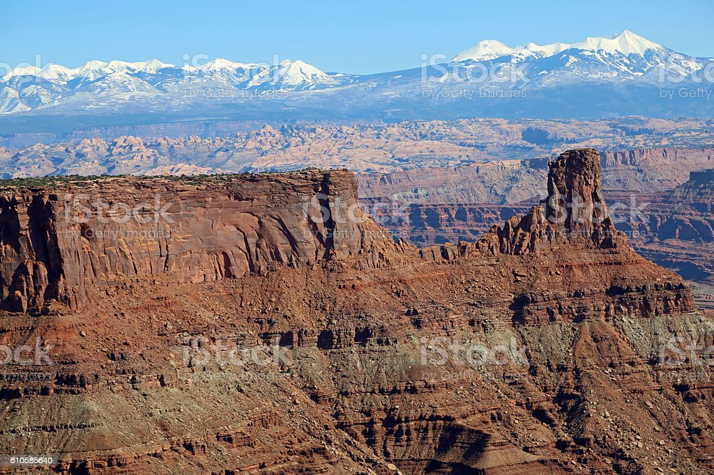 La Sal Mountains over eroded landscape stock photo