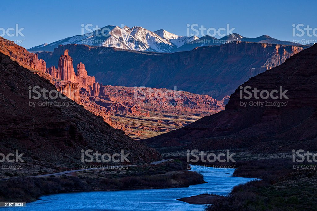 La Sal Mountains with Fisher Towers at Sunset stock photo