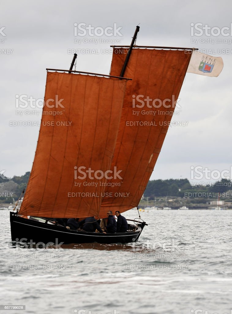 La Semaine du Golfe; bi-annual classic boat festival. A classic fishing boat with red sails. stock photo