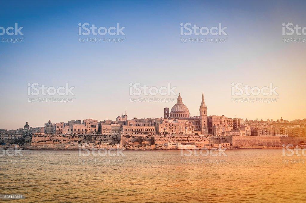 La Valletta at sunset from the sea - Malta capital stock photo