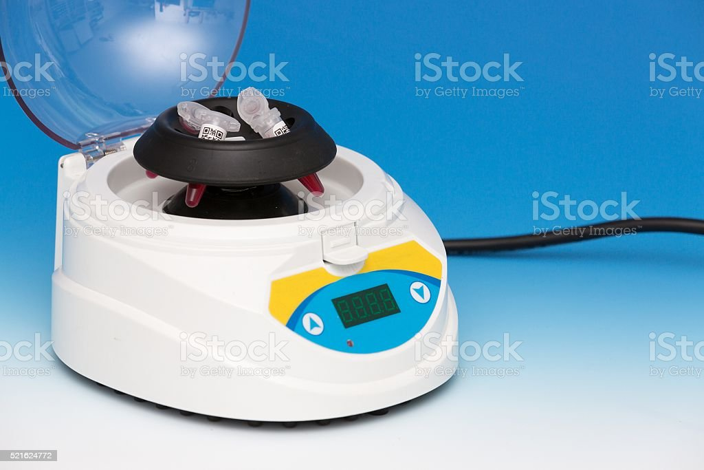 lab centrifuge with pcr tubes stock photo