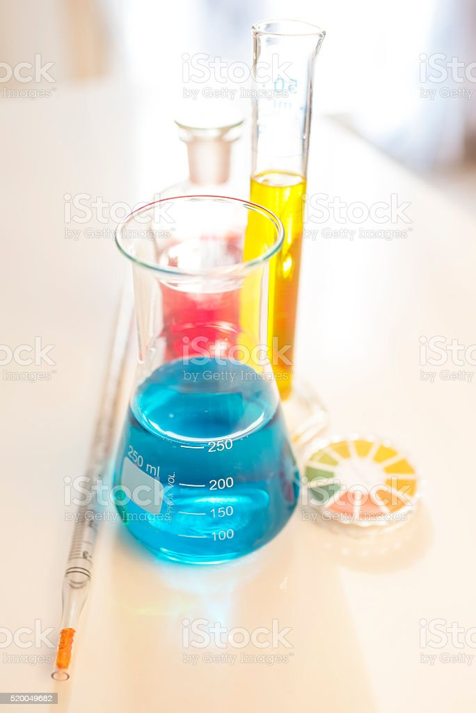 Lab Glass with a colored liquid over white stock photo