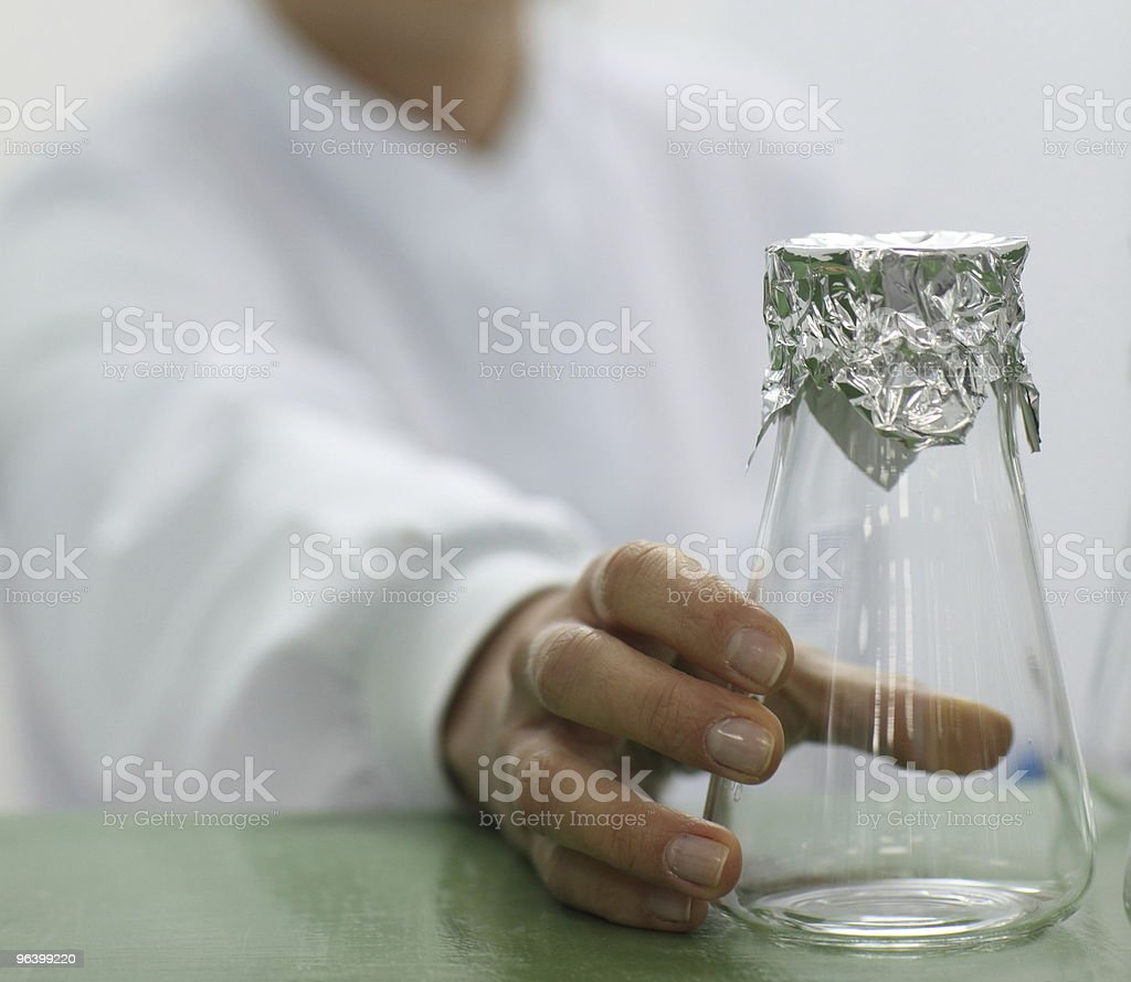 Lab technician holding a glass beaker royalty-free stock photo